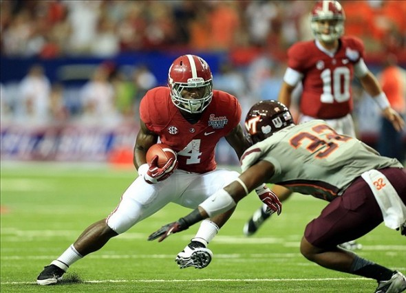 Aug 31, 2013; Atlanta, GA, USA; Alabama Crimson Tide running back T.J. Yeldon (4) carries the ball as he tries to escape Virginia Tech Hokies linebacker Josh Trimble (32) in the first quarter of the 2013 Chick-fil-a Kickoff game at the Georgia Dome. Daniel Shirey-USA TODAY Sports