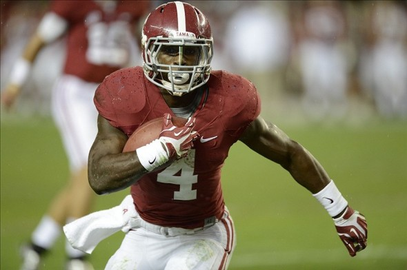Nov 9, 2013; Tuscaloosa, AL, USA; Alabama Crimson Tide running back T.J. Yeldon (4) carries the ball for a four ear touchdown during the third quarter against the LSU Tigers at Bryant-Denny Stadium. Mandatory Credit: John David Mercer-USA TODAY Sports