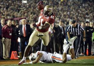 Jan 6, 2014; Pasadena, CA, USA; Florida State Seminoles fullback Chad Abram (41) gets past Auburn Tigers defensive back Ryan Smith (24) to score a touchdown during the second half of the 2014 BCS National Championship game at the Rose Bowl. Robert Hanashiro-USA TODAY Sports