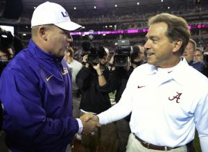 Nov 9, 2013; Tuscaloosa, AL, USA; LSU Tigers head coach Les Miles and Alabama Crimson Tide head coach Nick Saban greet each other midfield before the start of their game at Bryant-Denny Stadium. Mandatory Credit: John David Mercer-USA TODAY Sports