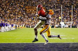 Nov 8, 2014; Baton Rouge, LA, USA; Alabama Crimson Tide wide receiver DeAndrew White (2) catches a touchdown over LSU Tigers safety Jalen Mills (28) during the overtime of a game at Tiger Stadium. Alabama defeated LSU 20-13 in overtime. Mandatory Credit: Derick E. Hingle-USA TODAY Sports