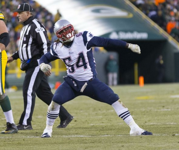 Nov 30, 2014; Green Bay, WI, USA; New England Patriots linebacker Dont'a Hightower (54) celebrates a sack during the second quarter against the Green Bay Packers at Lambeau Field. Mandatory Credit: Jeff Hanisch-USA TODAY Sports