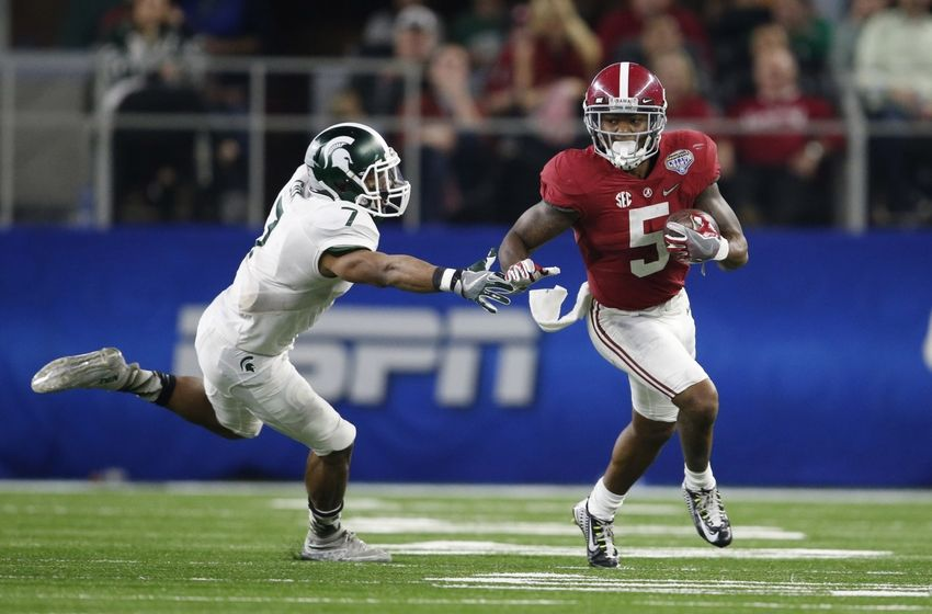 Dec 31, 2015; Arlington, TX, USA; Alabama Crimson Tide cornerback Cyrus Jones (5) returns a punt in the 2015 CFP semifinal at the Cotton Bowl against Michigan State Spartans cornerback Demetrious Cox (7) at AT&T Stadium. Mandatory Credit: Matthew Emmons-USA TODAY Sports