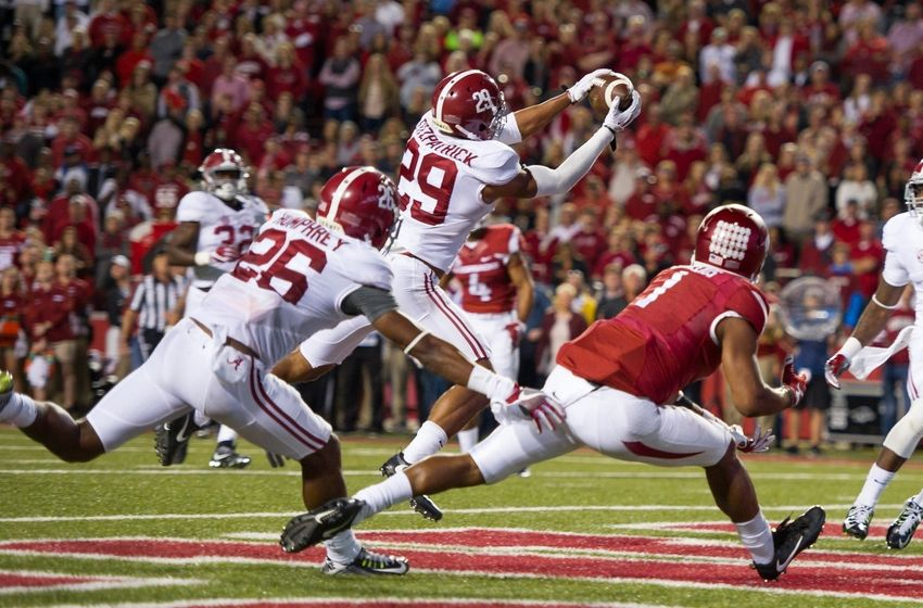 Oct 8, 2016; Fayetteville, AR, USA; Alabama Crimson Tide defensive back Minkah Fitzpatrick (29) intercepts the ball intended for Arkansas Razorbacks wide receiver Jared Cornelius (1) during the fourth quarter at Donald W. Reynolds Razorback Stadium. Mandatory Credit: Brett Rojo-USA TODAY Sports