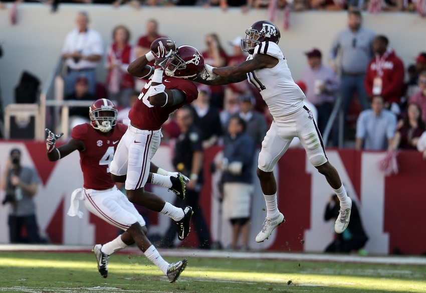 Oct 22, 2016; Tuscaloosa, AL, USA; Alabama Crimson Tide defensive back Marlon Humphrey (26) intercepts the ball from Texas A&M Aggies wide receiver Josh Reynolds (11) at Bryant-Denny Stadium. Mandatory Credit: Marvin Gentry-USA TODAY Sports