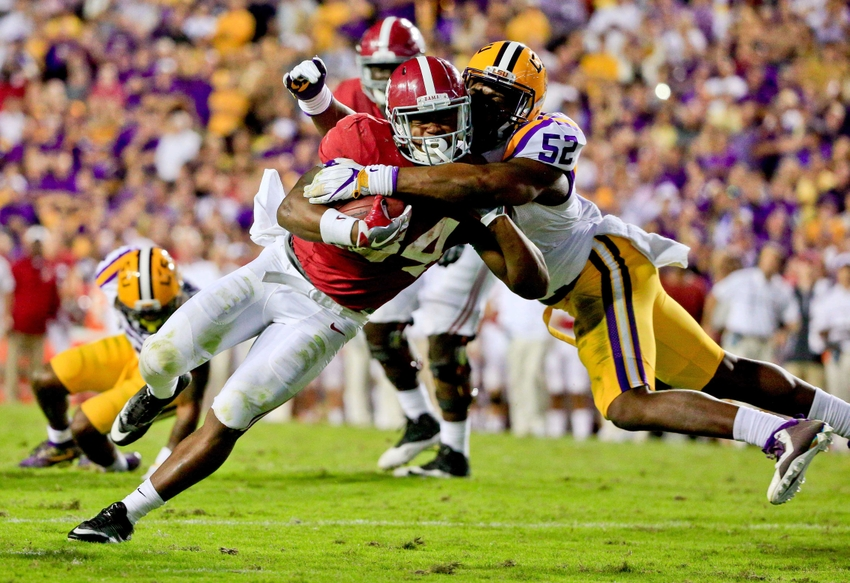 Nov 5, 2016; Baton Rouge, LA, USA; LSU Tigers linebacker Kendell Beckwith (52) tackles Alabama Crimson Tide running back Damien Harris (34) during the second half of a game at Tiger Stadium. Alabama defeated LSU 10-0. Mandatory Credit: Derick E. Hingle-USA TODAY Sports