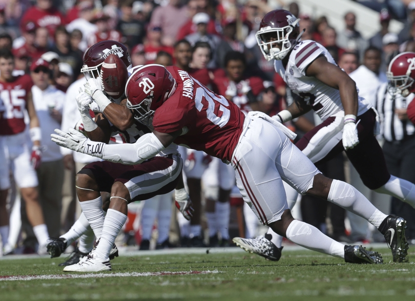 Nov 12, 2016; Tuscaloosa, AL, USA; Mississippi State Bulldogs wide receiver Keith Mixon (23) is hit by Alabama Crimson Tide linebacker Shaun Dion Hamilton (20) at Bryant-Denny Stadium. Mandatory Credit: Marvin Gentry-USA TODAY Sports