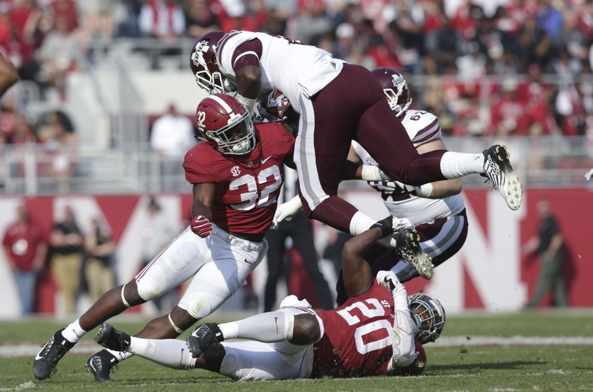 Nov 12, 2016; Tuscaloosa, AL, USA; Alabama Crimson Tide linebacker Shaun Dion Hamilton (20) and linebacker Rashaan Evans (32) hit Mississippi State Bulldogs tight end Jordan Thomas (83) at Bryant-Denny Stadium. The Tide defeated the Bulldogs 51-3. Mandatory Credit: Marvin Gentry-USA TODAY Sports