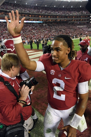 Nov 26, 2016; Tuscaloosa, AL, USA; Alabama Crimson Tide quarterback Jalen Hurts (2) waves to the fans following the Tides 30-12 victory against the Auburn Tigers at Bryant-Denny Stadium. Mandatory Credit: John David Mercer-USA TODAY Sports