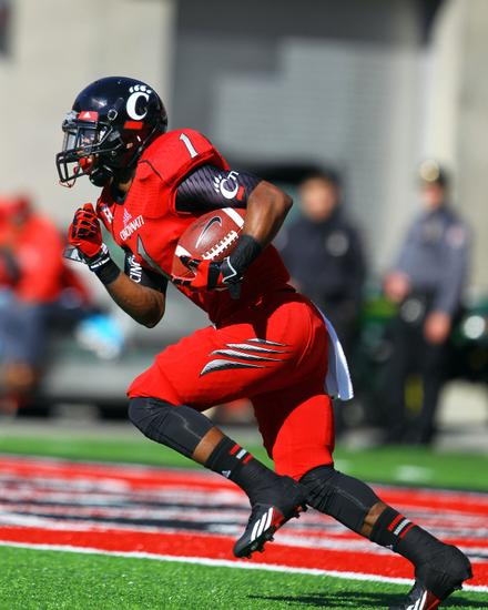 Nov 9, 2013; Cincinnati, OH, USA; Cincinnati Bearcats running back Ralph David Abernathy IV (1) returns a kick during the first quarter of the game against the Southern Methodist Mustangs at Nippert Stadium. Mandatory Credit: Rob Leifheit-USA TODAY Sports