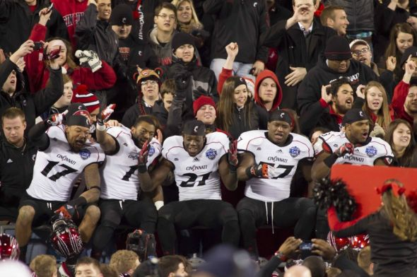 Dec 27, 2012; Charlotte, NC, USA; Cincinnati Bearcats players celebrate with fans after defeating the Duke Blue Devils in the Belk Bowl at Bank of America Stadium. Cincinnati won 48-34. Mandatory Credit: Jeremy Brevard-USA TODAY Sports