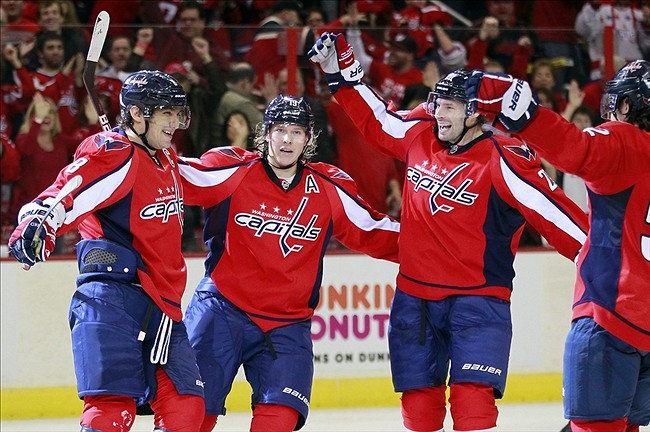 January 27, 2013; Washington, DC, USA; Washington Capitals left wing Alex Ovechkin (8) celebrates with teammates after scoring a goal against the Buffalo Sabres in the third period at Verizon Center. The Capitals won 3-2. Mandatory Credit: Geoff Burke-USA TODAY Sports