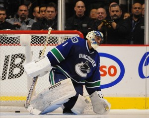 Jan 20, 2013; Vancouver, British Columbia, CANADA; Vancouver Canucks goaltender Roberto Luongo (1) reacts to the winning goal by Edmonton Oilers right wing Ales Hemsky (83), not pictured, during the third period at Rogers Arena. The Edmonton Oilers won 3-2 in a shootout. Mandatory Credit: Anne-Marie Sorvin-USA TODAY Sports