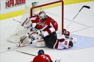 February 23, 2013; Washington, DC, USA; Washington Capitals goalie Braden Holtby (70) makes a save on New Jersey Devils right wing Steve Bernier (18) in the second period at Verizon Center. Mandatory Credit: Geoff Burke-USA TODAY Sports