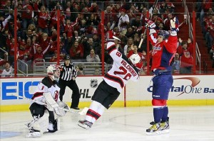 February 23, 2013; Washington, DC, USA; Washington Capitals left wing Alex Ovechkin (8) celebrates after scoring a goal against New Jersey Devils goalie Johan Hedberg (1) in the third period at Verizon Center. The Capitals won 5-1. Mandatory Credit: Geoff Burke-USA TODAY Sports