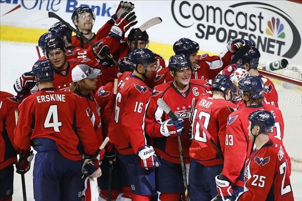 Oct 3, 2013; Washington, DC, USA; Washington Capitals players celebrate after their game against the Calgary Flames at Verizon Center. The Capitals won 5-4 in a shootout. Mandatory Credit: Geoff Burke-USA TODAY Sports