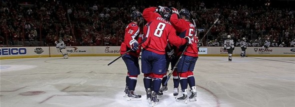 Nov 7, 2013; Washington, DC, USA; Washington Capitals right wing Alex Ovechkin (8) celebrates with teammates after scoring a goal against the Minnesota Wild in the first period at Verizon Center. The Capitals won 3-2 in a shootout. Mandatory Credit: Geoff Burke-USA TODAY Sports