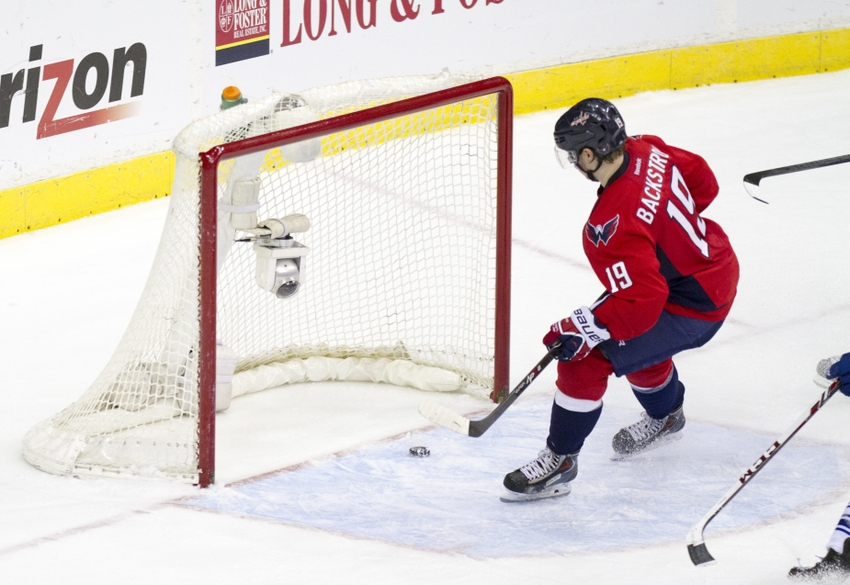 Mar 16, 2014; Washington, DC, USA; Washington Capitals center Nicklas Backstrom (19) watches the puck go in the net after a goal by Washington Capitals right wing Troy Brouwer (not pictured) against the Toronto Maple Leafs during the third period at Verizon Center.