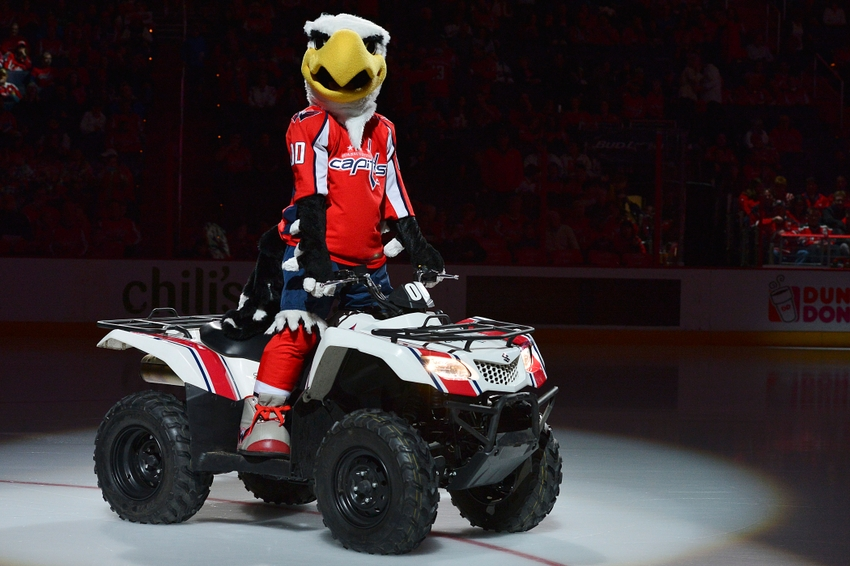 Feb 8, 2014; Washington, DC, USA; Washington Capitals mascot rides a 4-wheeler on the ice prior to the first period at Verizon Center.