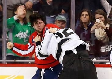Feb 16, 2016; Washington, DC, USA; Washington Capitals right wing Tom Wilson (43) fights Los Angeles Kings defenseman Luke Schenn (52) at Verizon Center. Mandatory Credit: Geoff Burke-USA TODAY Sports