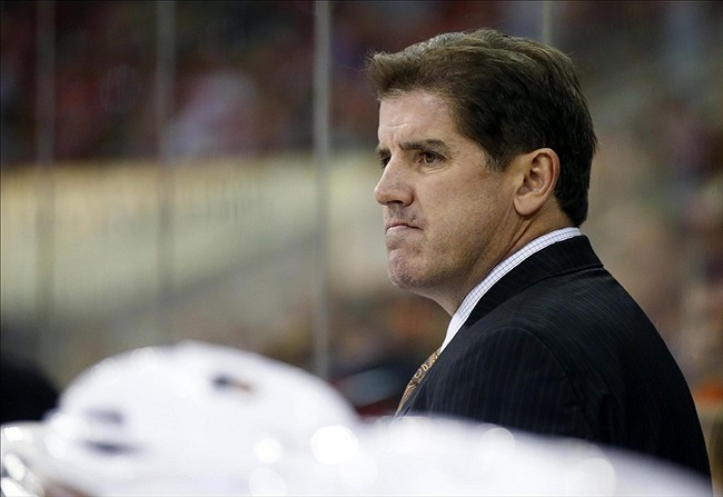 October 6, 2013; Raleigh, NC, USA; Philadelphia Flyers coach Peter Laviolette looks on against the Carolina Hurricanes at PNC Center. The Hurricanes defeated the Flyers 2-1. Mandatory Credit: James Guillory-USA TODAY Sports