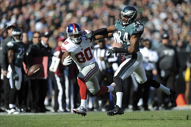Philadelphia Eagles cornerback Bradley Fletcher (24) interferes with New York Giants wide receiver Victor Cruz (80) during the first half at Lincoln Financial Field. Mandatory Credit: Joe Camporeale-USA TODAY Sports