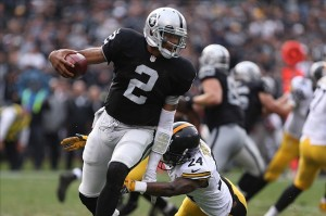 Oct 27, 2013; Oakland, CA, USA; Oakland Raiders quarterback Terrelle Pryor (2) elects to run ahead of Pittsburgh Steelers cornerback Ike Taylor (24) during the third quarter at O.co Coliseum. The Oakland Raiders defeated the Pittsburgh Steelers 21-18. Mandatory Credit: Kelley L Cox-USA TODAY Sports