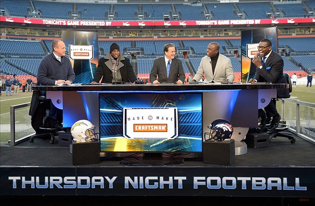 Dec 12, 2013; Denver, CO, USA; General view of Rich Eisen (left), Deion Sanders (second from left), Steve Mariucci (center), Marshall Faulk (second from right) and Michael Irvin on the NFL Network set before the game between the San Diego Chargers and the Denver Broncos at Sports Authority Field at Mile High. Mandatory Credit: Kirby Lee-USA TODAY Sports
