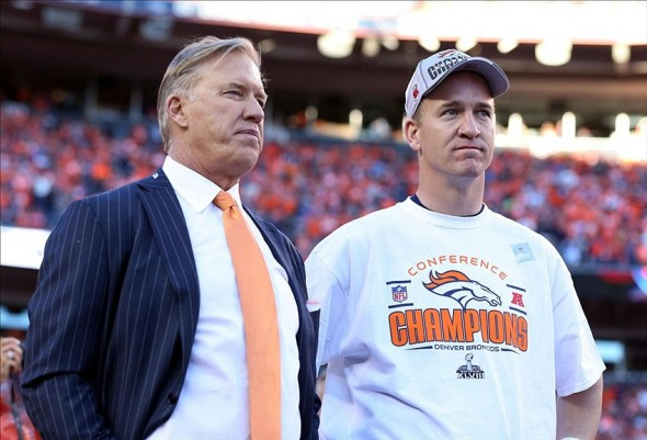 Jan 19, 2014; Denver, CO, USA; Denver Broncos executive vice president of football operations John Elway and quarterback Peyton Manning (18) after the 2013 AFC championship playoff football game against the New England Patriots at Sports Authority Field at Mile High. Mandatory Credit: Matthew Emmons-USA TODAY Sports