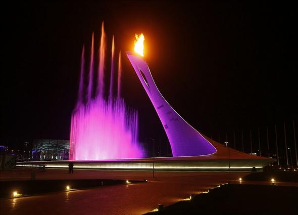 Feb 7, 2014; Sochi, RUSSIA; Colored lights illuminate the fountain at the base of the cauldron following the opening ceremony for the Sochi 2014 Olympic Winter Games at Fisht Olympic Stadium. Mandatory Credit: Nathan Bilow-USA TODAY Sports