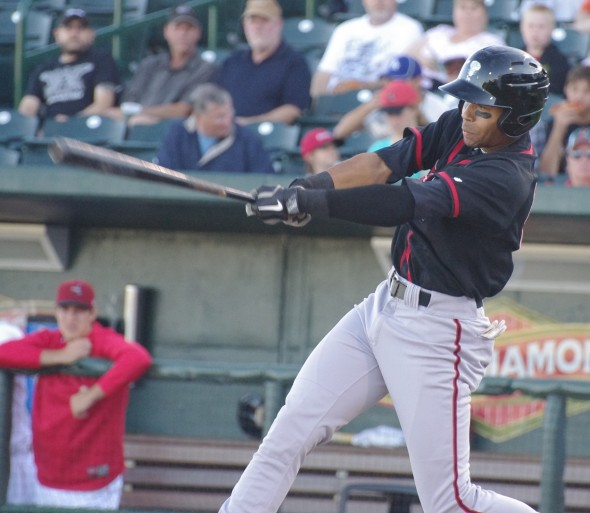 Dalton Pompey of the Lansing Lugnuts takes a cut at Dow Diamond, home of the Great Lakes Loons in Midland, Michigan on August 10, 2013. Mandatory Credit: Jay Blue