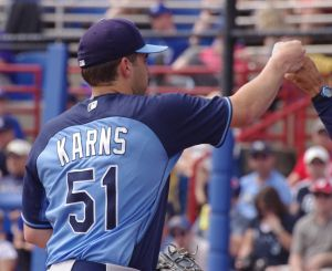 Nathan Karns of the Tampa Bay Rays fist bumps a disembodied hand after coming out of the game against the Toronto Blue Jays on March 12, 2014 in Dunedin, Florida. Mandatory Credit: Jay Blue
