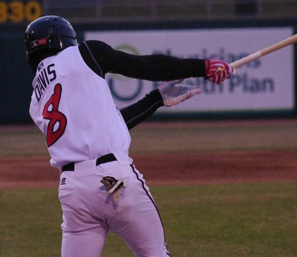 D.J. Davis (8) takes a swing on April 10, 2014 in Lansing, Michigan for the Lansing Lugnuts. Mandatory Credit: Jay Blue