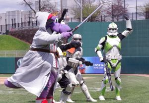 Big Lug dances with some new friends in between innings at Cooley Law School Stadium in Lansing, Michigan on May 4, 2014. Mandatory Credit: Jay Blue