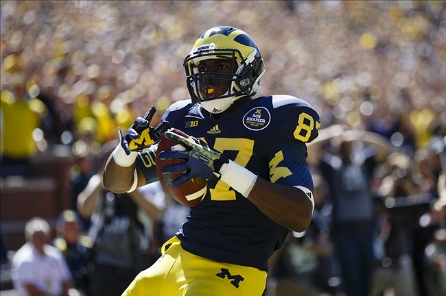 Sep 14, 2013; Ann Arbor, MI, USA; Michigan Wolverines tight end Devin Funchess (87) celebrates a touch down in the first quarter against the Akron Zips at Michigan Stadium. Mandatory Credit: Rick Osentoski-USA TODAY Sports