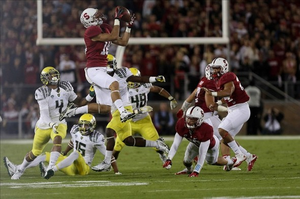 Nov 7, 2013; Stanford, CA, USA; Stanford Cardinal wide receiver Jeff Trojan (18) gathers the onside kick by the Oregon Ducks during the fourth quarter at Stanford Stadium. The Stanford Cardinal defeated the Oregon Ducks 26-20. Mandatory Credit: Kelley L Cox-USA TODAY Sports