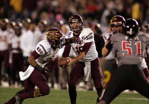 Dec 30, 2013; San Diego, CA, USA; Arizona State Sun Devils quarterback Taylor Kelly (10) hands the ball off to running back Deantre Lewis (25) in the second half at Qualcomm Stadium. Mandatory Credit: Michael C. Johnson-USA TODAY Sports