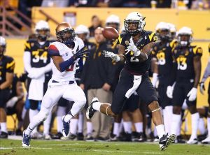 Nov 30, 2013; Tempe, AZ, USA; Arizona State Sun Devils wide receiver Jaelen Strong (right) catches a touchdown pass under pressure from Arizona Wildcats cornerback Shaquille Richardson in the second half of the 87th annual Territorial Cup at Sun Devil Stadium. Arizona State defeated Arizona 58-21. Mandatory Credit: Mark J. Rebilas-USA TODAY Sports