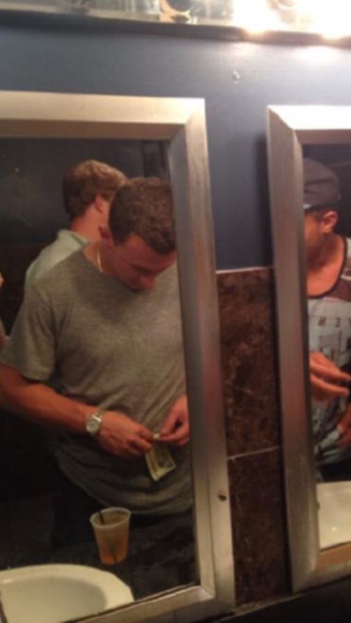 What is Johnny Manziel doing with that $20 bill and why? So many questions, so few answers.
