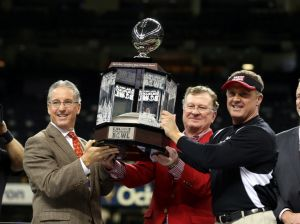 Dec 21, 2013; New Orleans, LA, USA; Louisiana-Lafayette Ragin Cajuns director of athletics Scott Farmer, university president Joseph Savoie and head coach Mark Hudspeth hold the R&L Carriers New Orleans Bowl trophy after defeating the Tulane Green Wave, 24-21, at the Mercedes-Benz Superdome. Mandatory Credit: Chuck Cook-USA TODAY Sports
