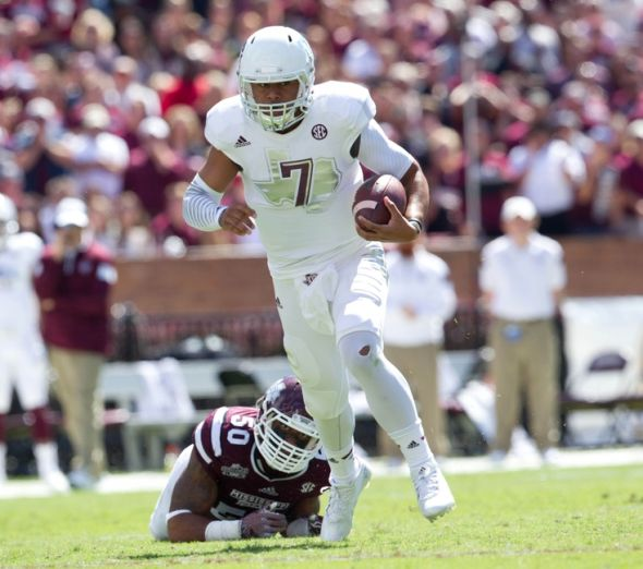 Oct 4, 2014; Starkville, MS, USA; Texas A&M Aggies quarterback Kenny Hill (7) gets out of the grasp of Mississippi State Bulldogs linebacker Benardrick McKinney (50) at Davis Wade Stadium. Mandatory Credit: Marvin Gentry-USA TODAY Sports