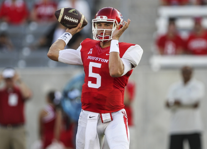 Oct 2, 2014; Houston, TX, USA; Houston Cougars quarterback John O'Korn (5) attempts a pass during the first quarter against the Central Florida Knights at TDECU Stadium. Mandatory Credit: Troy Taormina-USA TODAY Sports