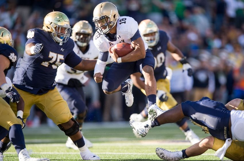 Oct 10, 2015; South Bend, IN, USA; Navy Midshipmen quarterback Tago Smith (18) runs the ball as Notre Dame Fighting Irish defensive lineman Daniel Cage (75) defends in the second quarter at Notre Dame Stadium. Mandatory Credit: Matt Cashore-USA TODAY Sports