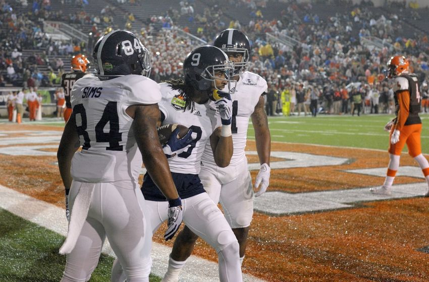 Dec 23, 2015; Mobile, AL, USA; Georgia Southern Eagles wide receiver Montay Crockett (9) celebrates his touchdown pass reception with wide receiver Andre Sims (84) and running back LA Ramsby (1) against the Bowling Green Falcons in the second quarter of the 2015 GoDaddy Bowl at Ladd-Peebles Stadium. Mandatory Credit: Glenn Andrews-USA TODAY Sports