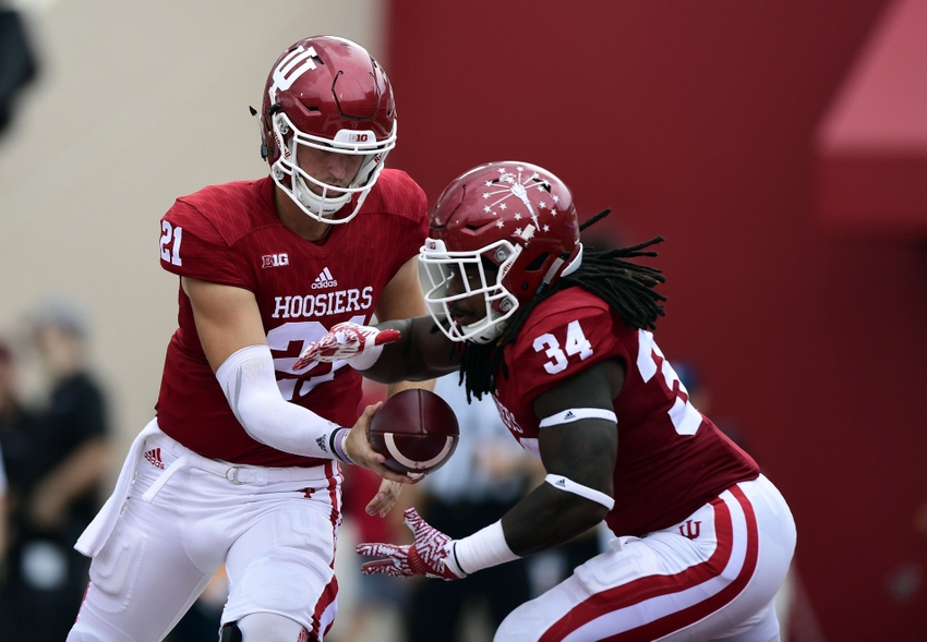 Sep 10, 2016; Bloomington, IN, USA; Indiana Hoosiers defensive back Leon Thornton III (21) hands the ball off to Indiana Hoosiers running back Devine Redding (34) during the first half of the game against the Indiana Hoosiers at Memorial Stadium. Mandatory Credit: Marc Lebryk-USA TODAY Sports