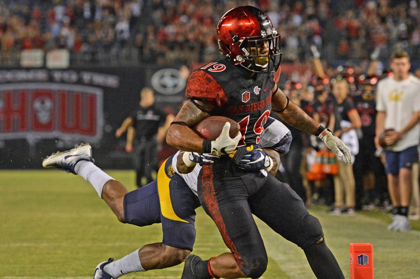 Sep 10, 2016; San Diego, CA, USA; San Diego State Aztecs running back Donnel Pumphrey (19) scores a touchdown as California Golden Bears cornerback Darius Allensworth (2) defends during the fourth quarterat Qualcomm Stadium. Mandatory Credit: Jake Roth-USA TODAY Sports