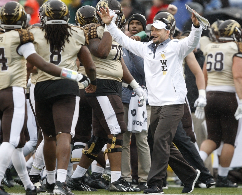 Nov 27, 2015; Toledo, OH, USA; Western Michigan Broncos head coach P.J. Fleck celebrates with his team during the third quarter against the Toledo Rockets at Glass Bowl. Broncos win 35-30. Mandatory Credit: Raj Mehta-USA TODAY Sports