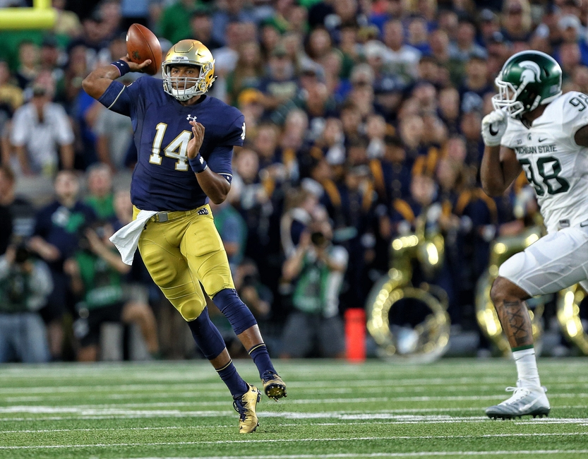 Sep 17, 2016; South Bend, IN, USA; Notre Dame Fighting Irish quarterback DeShone Kizer (14) attempts to throw the ball against the Michigan State Spartans during the first quarter of a game at Notre Dame Stadium. Mandatory Credit: Mike Carter-USA TODAY Sports