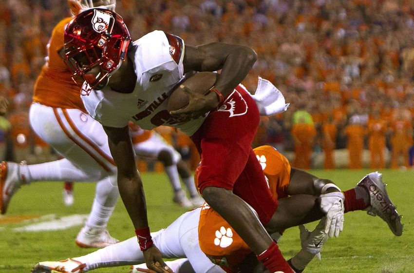Oct 1, 2016; Clemson, SC, USA; Clemson Tigers linebacker Kendall Joseph (34) attempts to bring down Louisville Cardinals quarterback Lamar Jackson (8) during the second quarter at Clemson Memorial Stadium. Mandatory Credit: Joshua S. Kelly-USA TODAY Sports