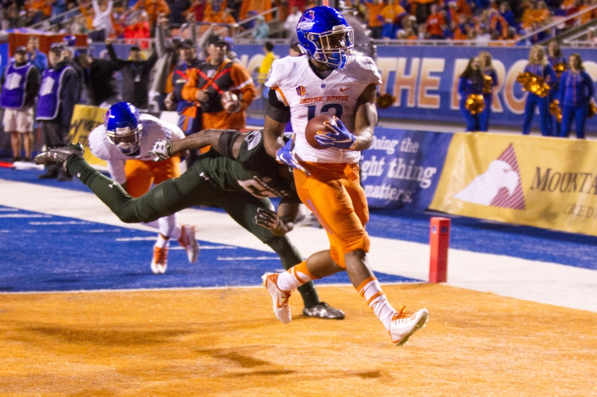 Oct 15, 2016; Boise, ID, USA; Boise State Broncos running back Jeremy McNichols (13) scores a touchdown during second half action against the Colorado State Rams at Albertsons Stadium. Boise State defeats Colorado State 28-23. Mandatory Credit: Brian Losness-USA TODAY Sports